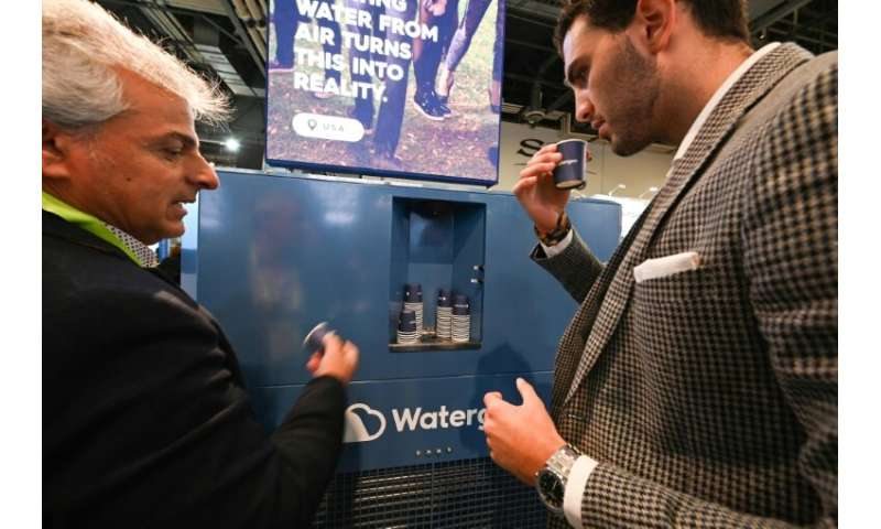 Attendees at CES 2019 in Las Vegas taste water created from the air by the Watergen GEN-350 device