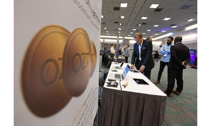 Attendees confer during the Crypto Funding Summit, which helps investors understand cryptocurrency, at the Convention Center in