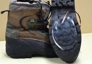 Hiking shoe with device attached. When falling snow on the surface of silicone </p> <div class=