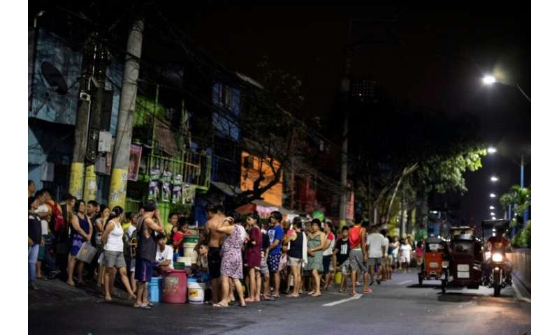 Bucket-bearing families  wait hours to fill up from tanker trucks and some hospitals to turn away less urgent cases in Manila