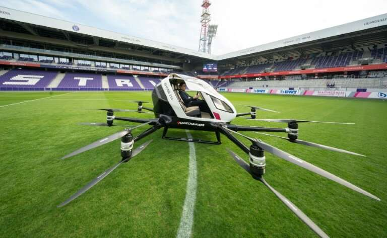 Chinese firm EHang unveiled its aircraft to assembled journalists in the Austrian capital's Generali Arena football stadium