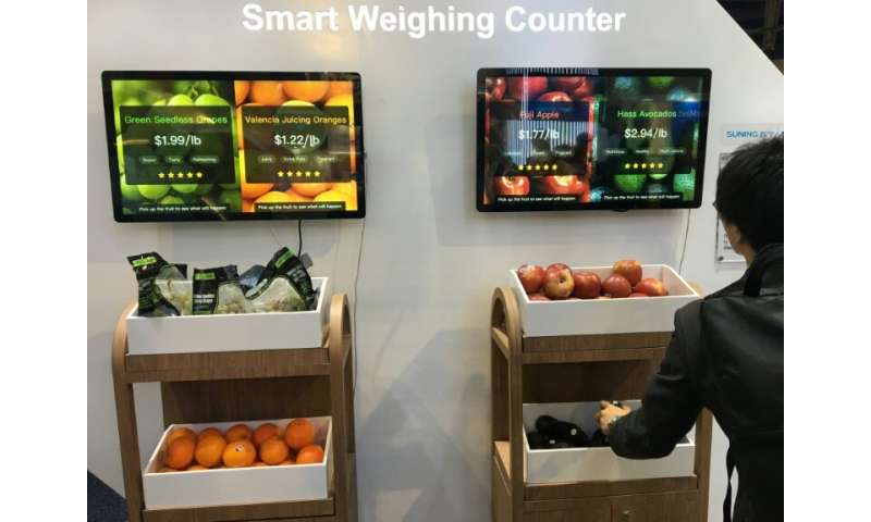 Chinese retail giant Suning's exhibit at the  Consumer Electronics Show shows a smart weighing counter that can enable consumers