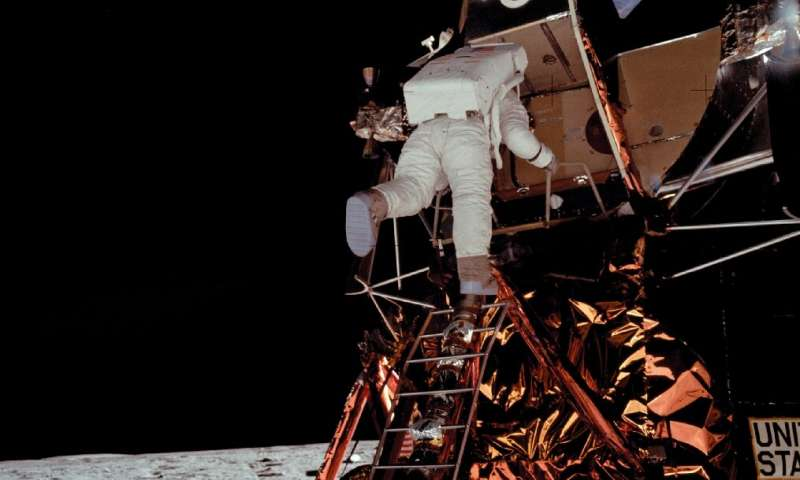 """Edwin """"Buzz"""" Aldrin descends from the lunar module to join Neil Armstrong on the Moon"""