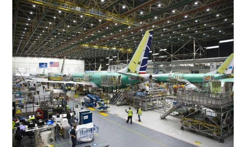 Employees work on Boeing 737 MAX airplanes at the factory in Renton, Washington