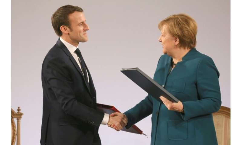 European news media associations wrote to French President Emmanuel Macron (L, pictured January 22, 2019) and German Chancellor