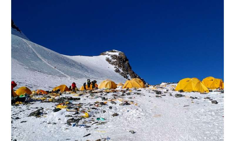 Fluorescent tents, discarded climbing equipment, empty gas canisters and even human excrement litter the well-trodden route to M