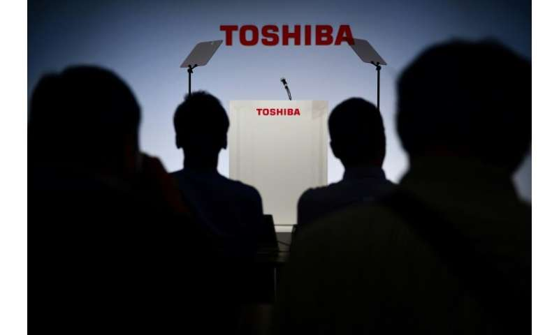 For the year to March, Toshiba said it now expects a net profit of 870 billion yen ($7.86 billion), down from a November estimat