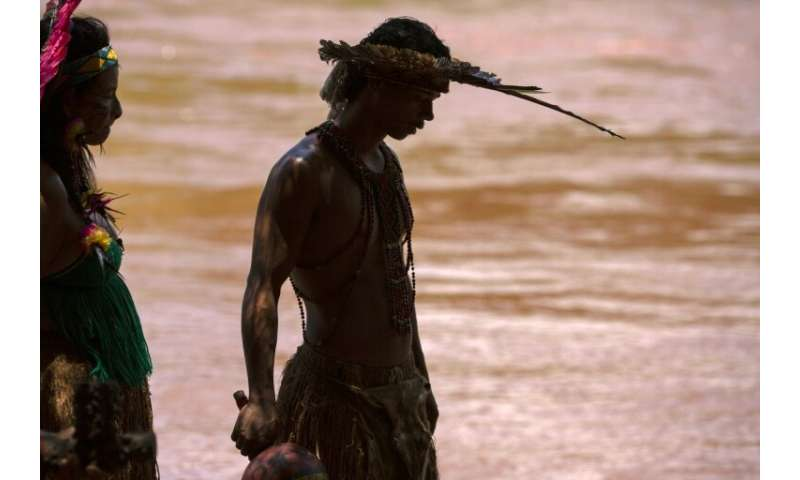 Hayo Pataxo ha-ha-hae, the 29-year-old leader of the indigenous community, looks at the Paraopeba river, filled with toxic mud f