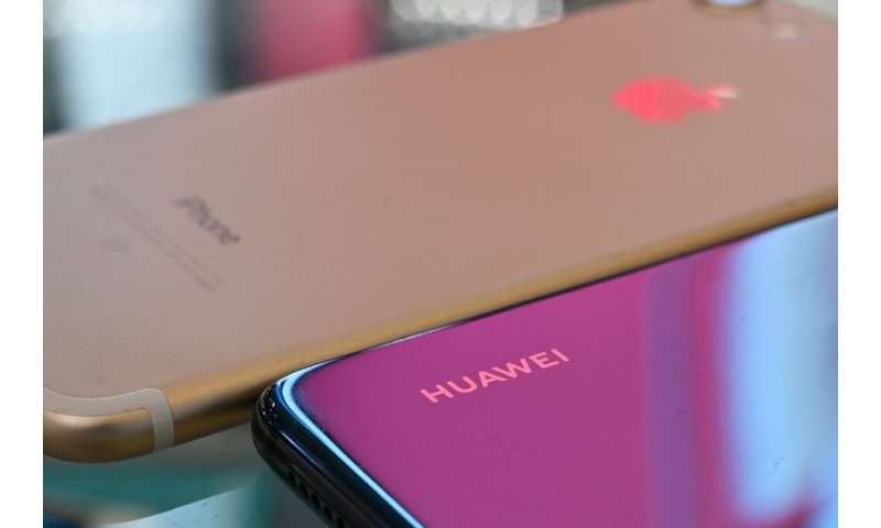 Huawei and Apple phones are displayed at a store in Shanghai