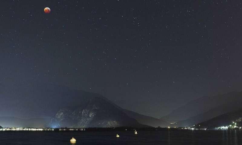 Image: Lunar eclipse over Lake Maggiore