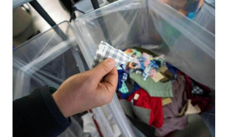 In the fabric sorting process at Fabscrap, labels and packaging must be removed