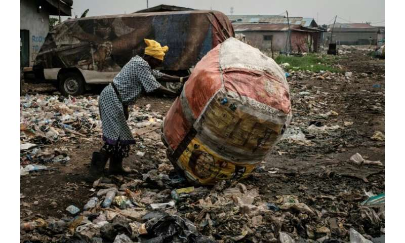 In the Mosafejo area of Lagos, plastic waste is being used to fill a swamp so that the land can be developed for housing