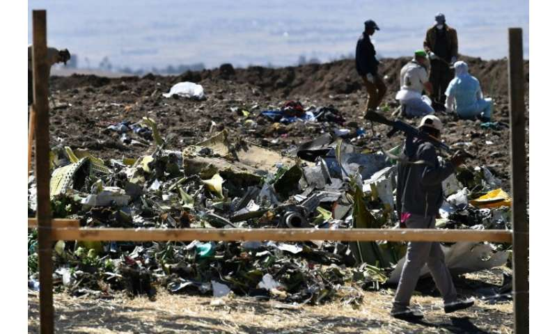 Investigators in Ethiopia comb the site of the Boeing 737 MAX crash on March 16, while flight data information will be scrutiniz