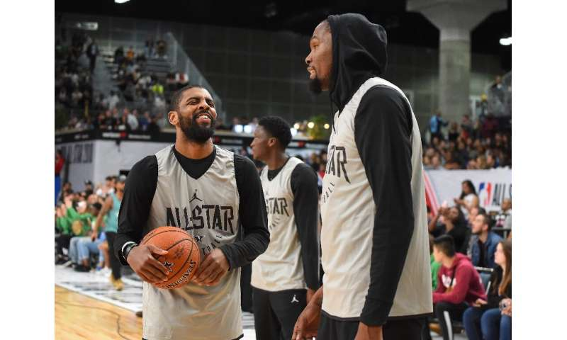 Kyrie Irving, left, and Kevin Durant of the Brooklyn Nets could have a new NBA boss as reports have Alibaba Group co-founder Jos