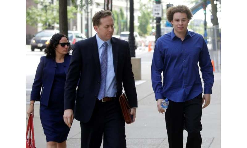 Marcus Hutchins (R), seen ahead of a 2017 court appearance, was hailed as a hero for stemming the WannaCry ransomware outbreak b