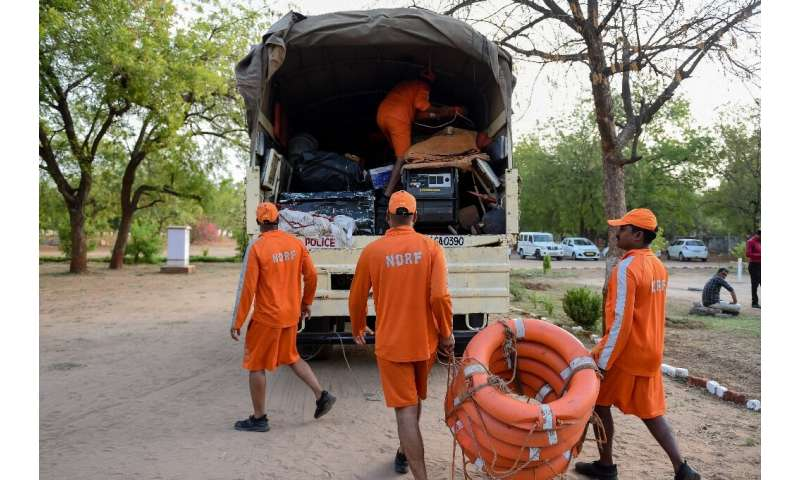 Members of India's 6th National Disaster Response Force (NDRF) load lifesaving gear onto a truck at an NDRF camp in Chiloda (als