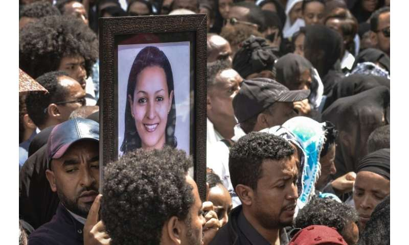 Mourners in Addis Ababa, Ethiopia carry portraits of victims from the Ethiopian Airlines crash