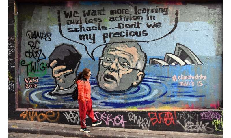 Mural in Melbourne shows Australian Prime Minister Scott Morrison holding a lump of coal as it advertises a rally by students ar