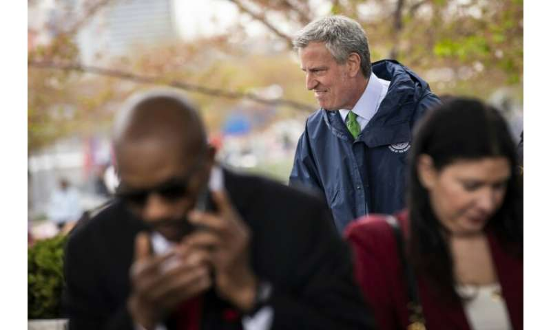 New York Mayor Bill de Blasio arrives at a press conference about the city's strategy to respond to climate change on April 22,