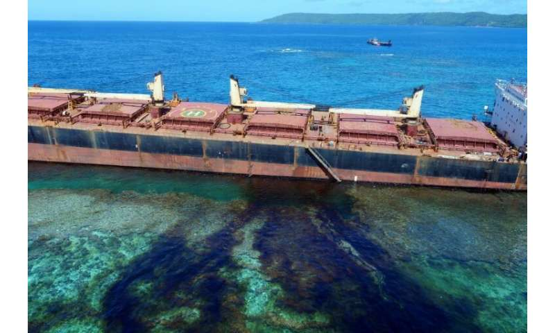 Oil is seen leaking from the MV Solomon Trader off the coast of Rennell Island, after the cargo vessel ran aground more than a m