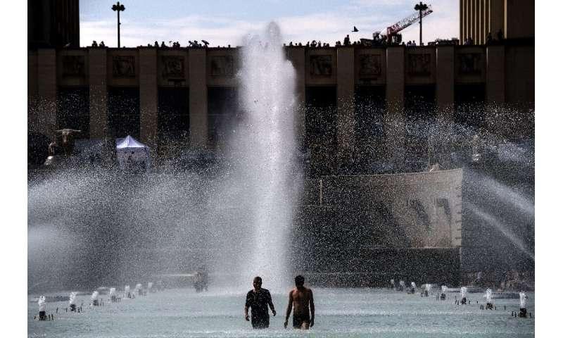 Paris's Trocadero esplanade proved a popular spot to cool off