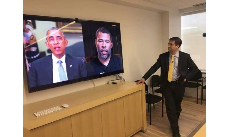 "Paul Scharre of the Center for a New American Security looks at a ""deepfake"" video of former US President Barack Obama"