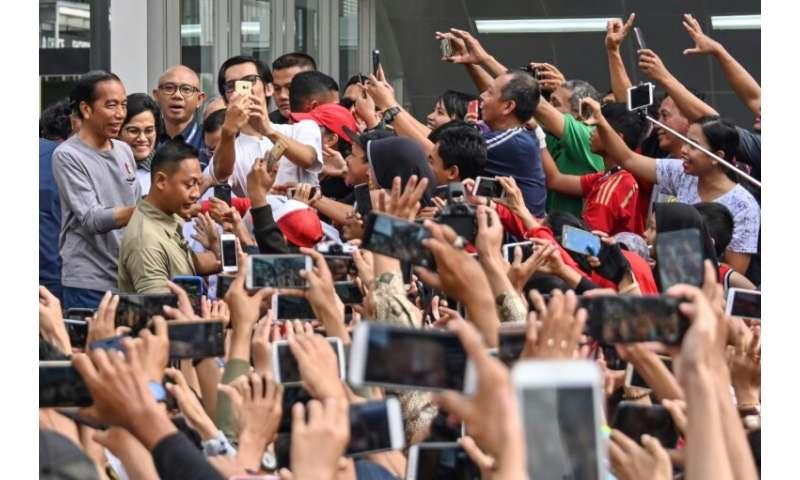 President Joko Widodo was among those on hand to unveil the new metro line