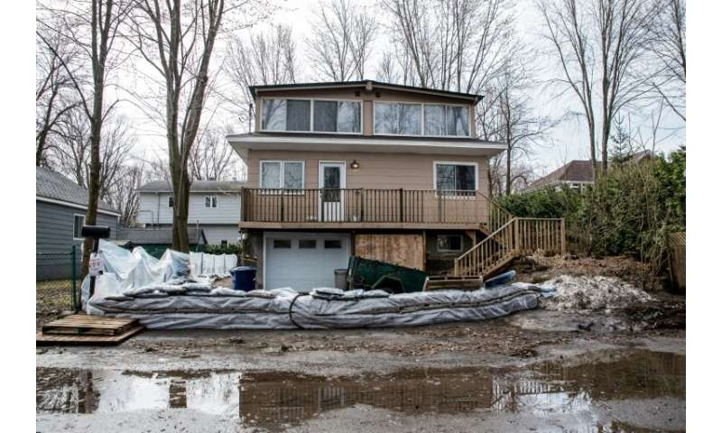 Residents in Laval, just north of Montreal, erected barriers with sandbags to ward off flooding