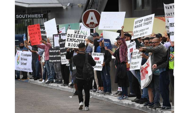 Rideshare drivers for Uber and Lyft stage a strike and protest at the LAX International Airport, over what they say are unfair w