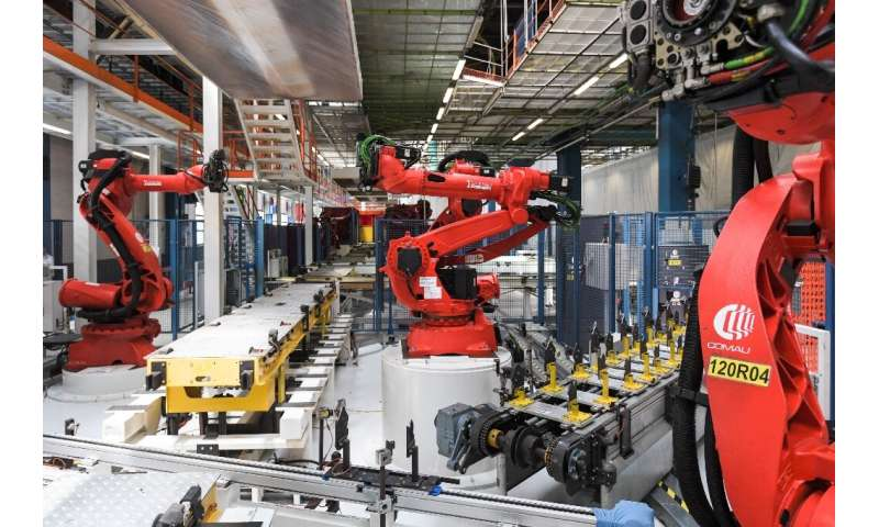 Robots manufactured by Comau are pictured on the assembly line of the Fiat 500 BEV Battery Electric Vehicle, the first of its ki