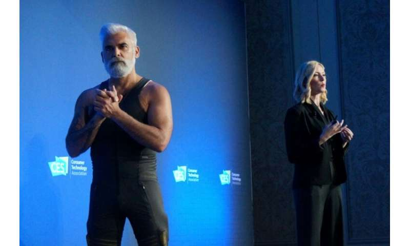 """Sarah Thomas (R) of California startup Seismic talks to the 2019 Consumer Electronics Show about """"powered clothing"""" us"""