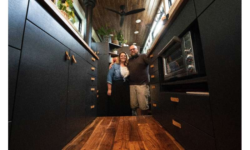 Scott Berrier and his wife Melissa—seen inside their tiny home in Elizabethtown, Pennsylvania—say they are happy with a more min