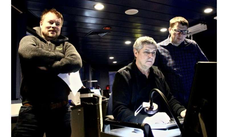 Second officer Valtteri Salokannel (L) and ship captain Pasi Jarvelin (C) are among around 16 crew members on board Polaris