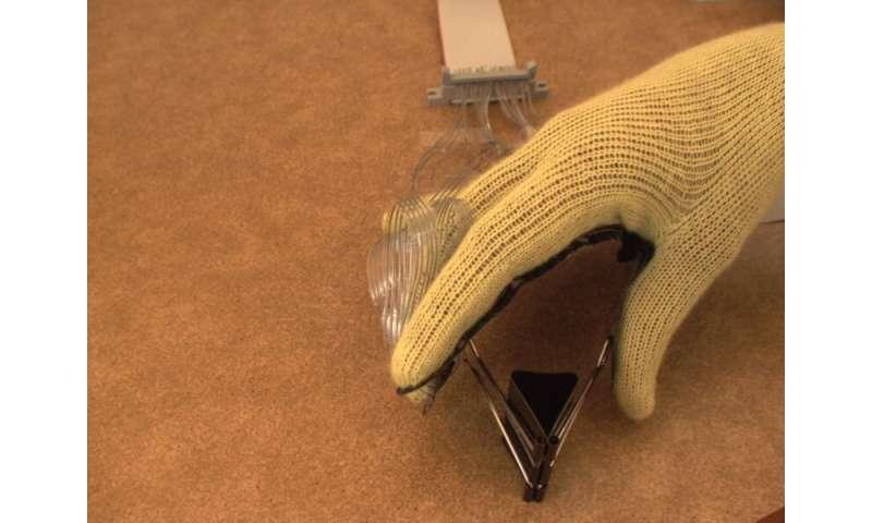 Sensor-laden glove helps robotic hands 'Feel' objects