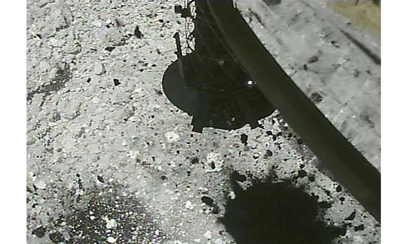 Stone and sand were thrown up on the Ryugu asteroid after Hayabusa2 fired a bullet into the surface in February to puff up dust