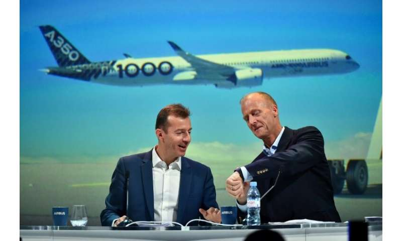 The 37-million-euro retirement package for outgoing Airbus CEO Tom Enders, right, sparked controversy in France