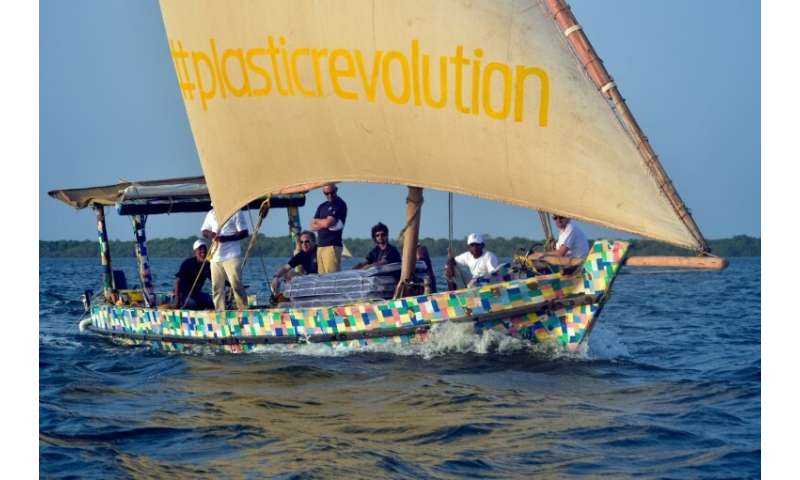 The boat is covered in a brightly-coloured patchwork of 30,000 flip-flops, which like the rest of the raw material was collected