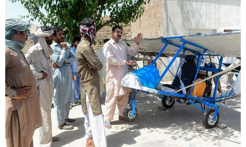 The engine is from a roadcutter, the wings are burlap, the wheels are borrowed from a rickshaw: a Pakistani popcorn seller has c