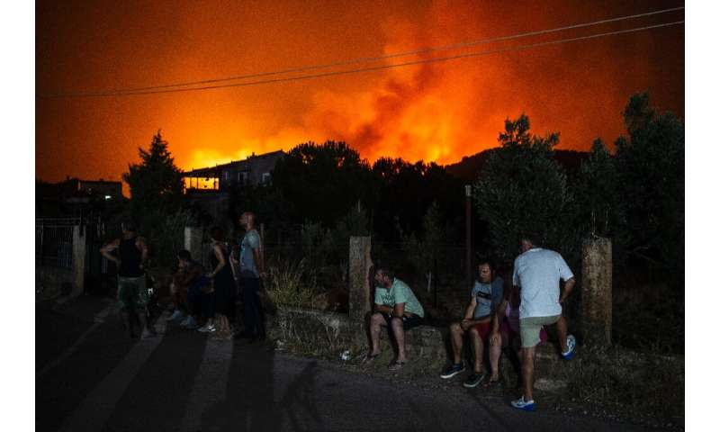 The fire that broke out in the early hours of Tuesday on Greece's second-largest island prompted the evacuation of several  vill