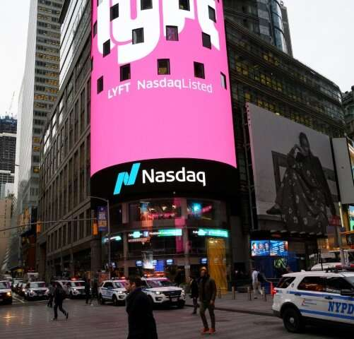 The Lyft logo is shown on the screen in Times Square after its stock debuted on Wall Street