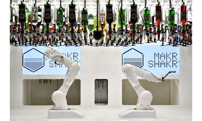 There are robots of all shapes and sizes, including a large mechanical arm that mixes and shakes cocktails