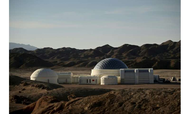 The white-coloured base has a silver dome and nine modules, including living quarters, a control room, a greenhouse and an airlo