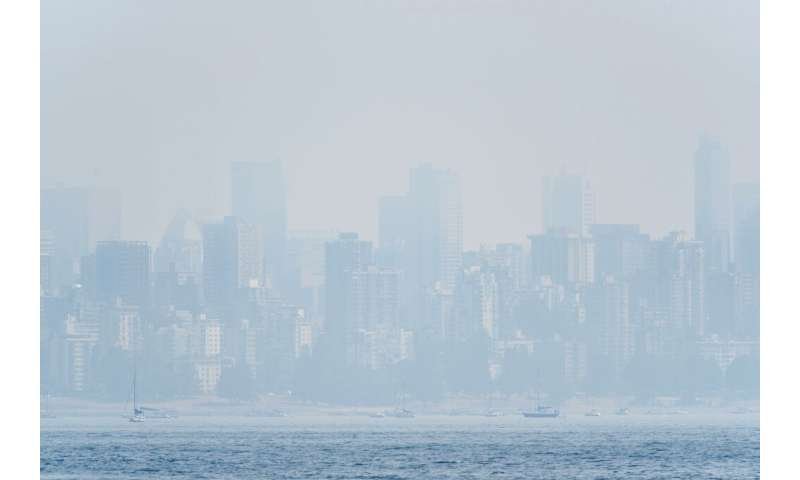 This file photo taken on August 21, 2018 shows heavy haze on the skyline of Vancouver, Canada as seen from Jericho Beach
