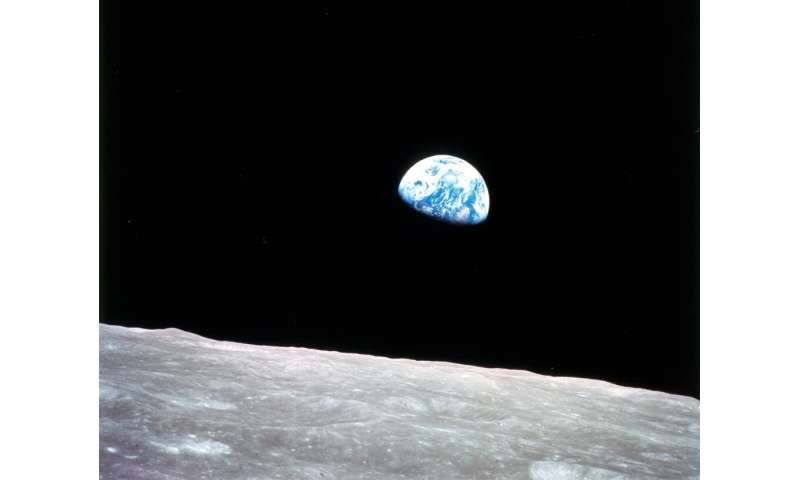 This NASA image shows the Earth as seen from Apollo 8 as it entered lunar orbit on December 24, 1968