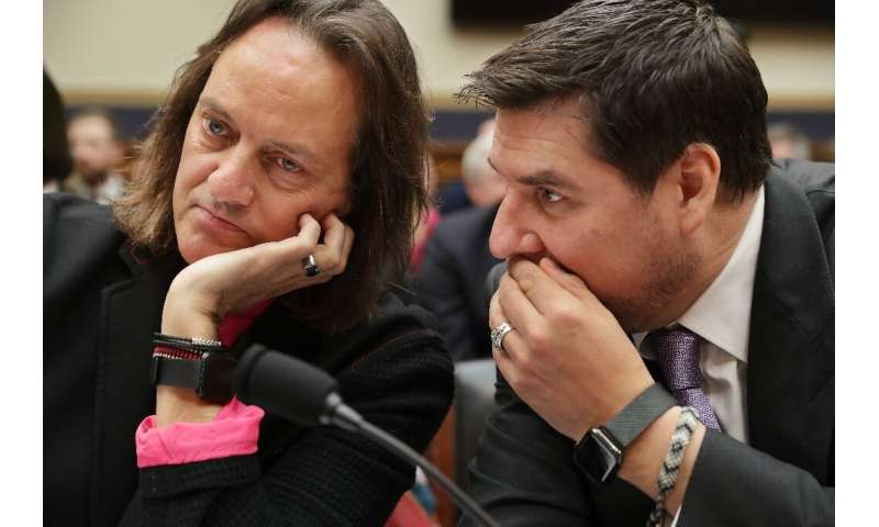 T-Mobile CEO John Legere and executive chairman of Sprint Marcelo Claure talk before testifying at the House of Representatives