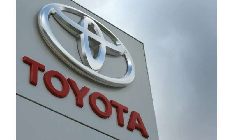 Toyota said build a new hybrid car at its Welsh plant in Deeside and its factory in Burnaston, central England