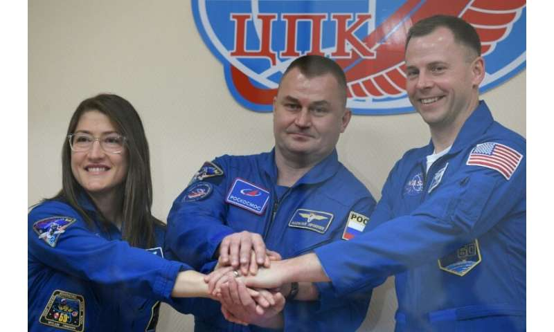US astronauts Christina Koch and Nick Hague (R) and Russian cosmonaut Alexey Ovchinin are scheduled to travel to the Internation