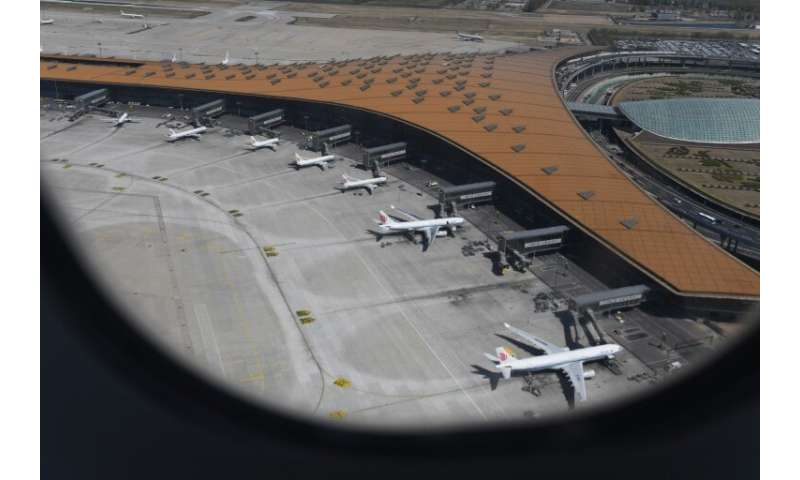 Various Airbus A330 and Boeing 737 planes of Air China parked at  Beijing's capital airport