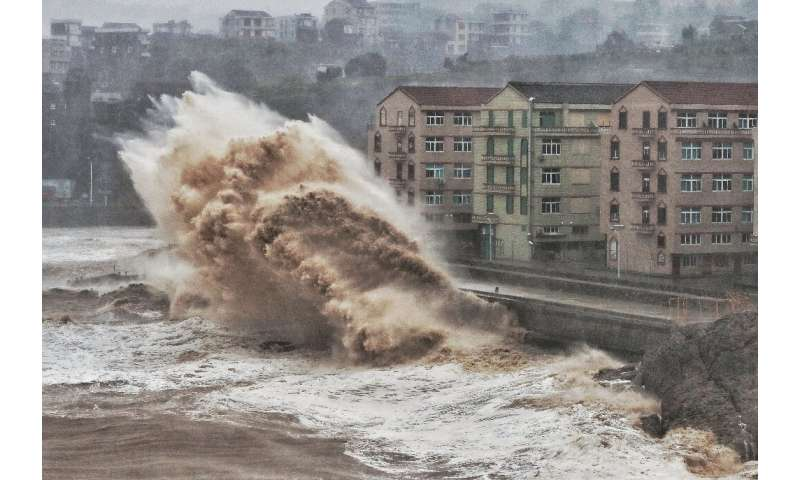 Waves hit a sea wall in Taizhou in China's eastern Zhejiang province, battered by Super Typhoon Lekima