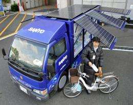 Japanese electronics giant Sanyo Electric displays a truck with solar panels for charging electric powered bicycles